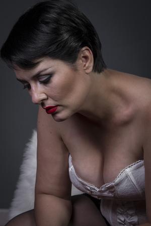 Sensual brunette woman in white lingerie photo