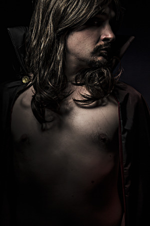 Vampire with black coat and long hair photo