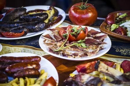 Mediterranean food plates, European cuisine, medieval fair in Spain photo