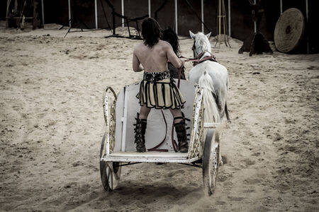 Roman chariot in a fight of gladiators, bloody circus photo