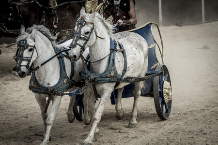 Epic, Roman chariot in a fight of gladiators, bloody circus photo