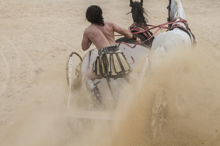 Roman chariots in the circus arena riding horses photo
