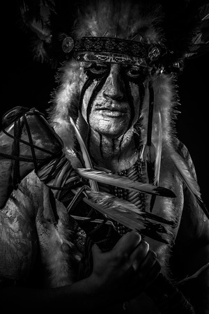 native american man: American Indian chief with big feather headdress, warrior