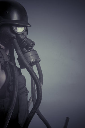 Protection, Man with black gas mask, pollution concept and ecological disaster photo