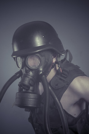 Factory, Man with black gas mask, pollution concept and ecological disaster photo