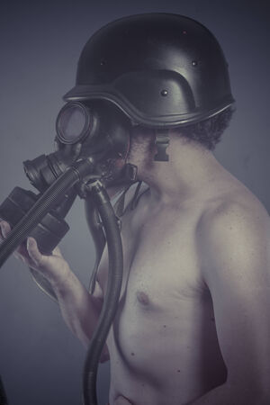 Man with black gas mask, pollution concept and ecological disaster photo