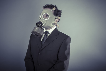 Industry, Business man wearing a gask mask, pollution concept photo