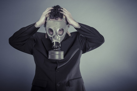 Risk, Business man wearing a gask mask, pollution concept photo