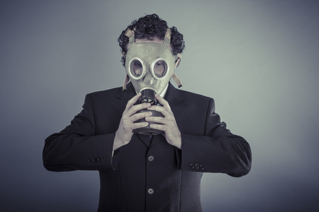 Disaster, Business man wearing a gask mask, pollution concept photo