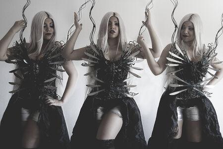 Three beautiful women, clones with gothic black dress