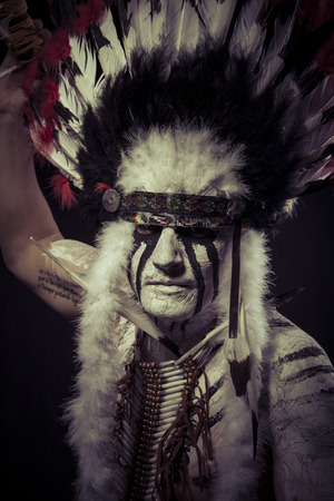 American Indian chief with big feather headdress photo