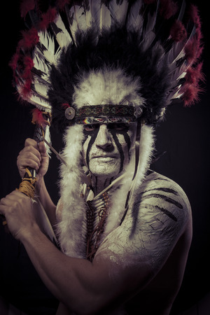 Native, American Indian chief with big feather headdress photo
