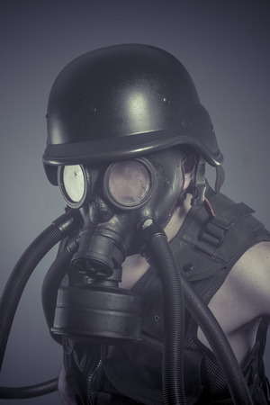 Inhalation, Man with black gas mask, pollution concept and ecological disaster photo