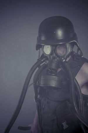 Radiation, Man with black gas mask, pollution concept and ecological disaster photo