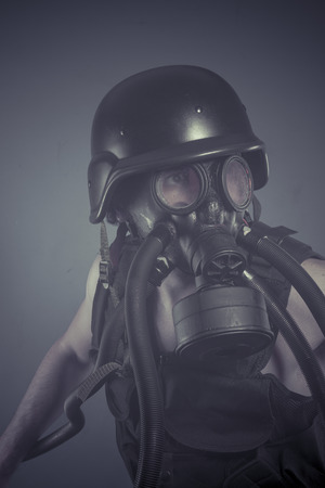 Survival, Man with black gas mask, pollution concept and ecological disaster photo