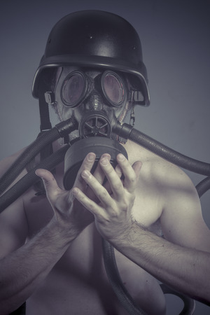 Nuclear, Man with black gas mask, pollution concept and ecological disaster photo