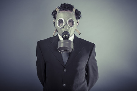 Hazard, Business man wearing a gask mask, pollution concept photo
