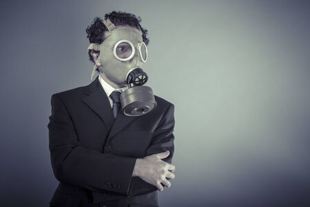 Nuclear, Business man wearing a gask mask, pollution concept photo