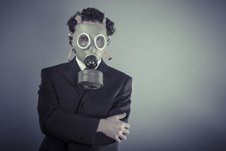 Environment, Business man wearing a gask mask, pollution concept photo