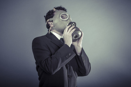 Chemical, Business man wearing a gask mask, pollution concept photo