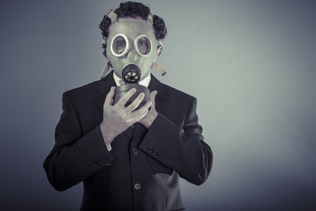 Apocalypse, Business man wearing a gask mask, pollution concept photo