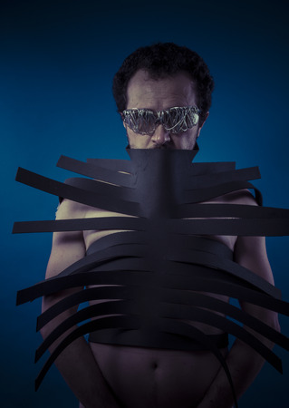 Bdsm, man covered with black strips, shibari concept art photo