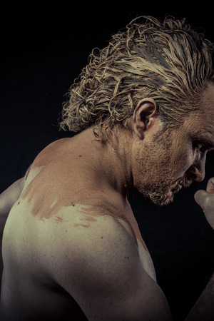 man with mud all over his body, naked, conceptual art photo