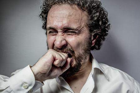 derision: derision, man with intense expression, white shirt