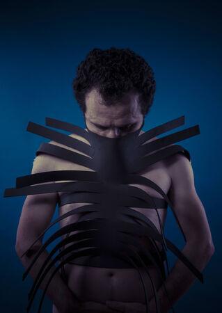 bdsm handcuff: Bdsm, man covered with black strips, shibari concept art