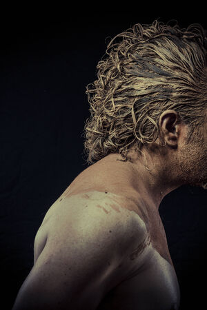 man with mud all over his body,  conceptual art photo