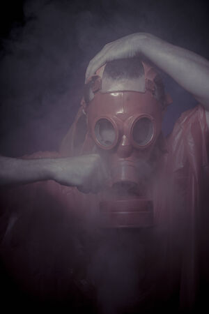 Protection, nuclear disaster, man with red mask and plastic suit photo
