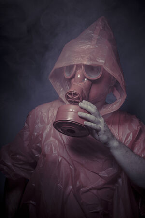 Ecology, nuclear disaster, man with red mask and plastic suit photo