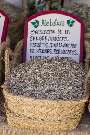 Dried, wicker baskets stuffed medicinal healing herbs photo