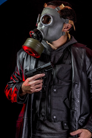 Private detective with bulletproof vest and gas mask photo