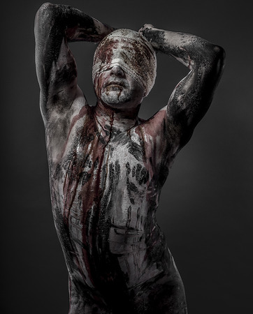 liberate: man with blood and blindfolded concept of prison, without freedom Stock Photo