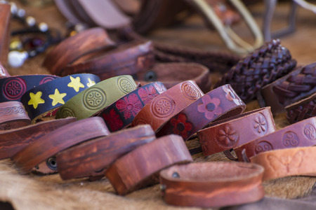 Store handmade  leather belts, spanish medieval fair photo