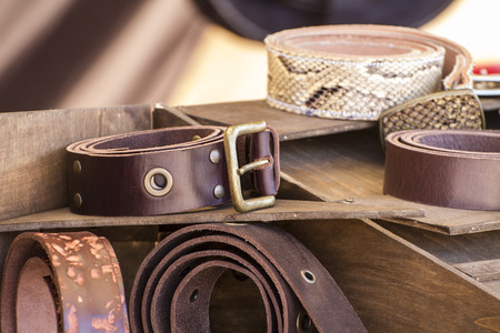 Store handmade  leather belts, spanish medieval fair, couro Stok Fotoğraf