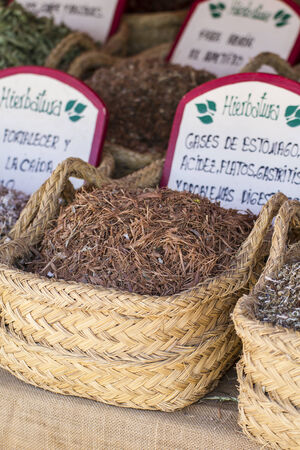 Apothecary, wicker baskets stuffed medicinal healing herbs photo