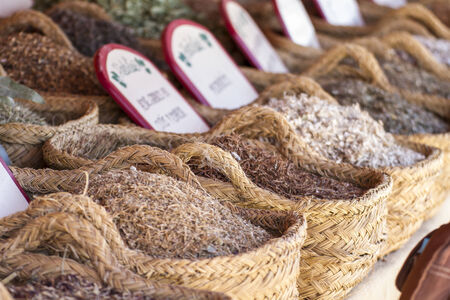 Herbal, wicker baskets stuffed medicinal healing herbs photo