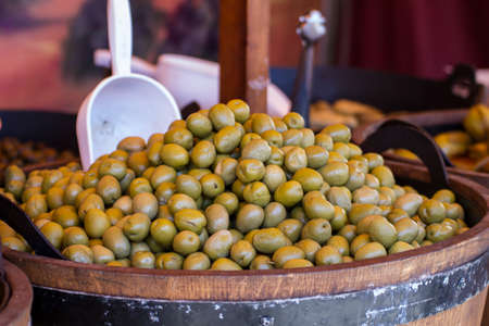 Wooden drums with olives and variants photo
