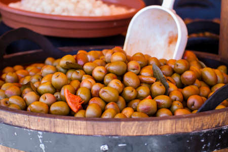 variants: Nutrition, Wooden drums with olives and variants