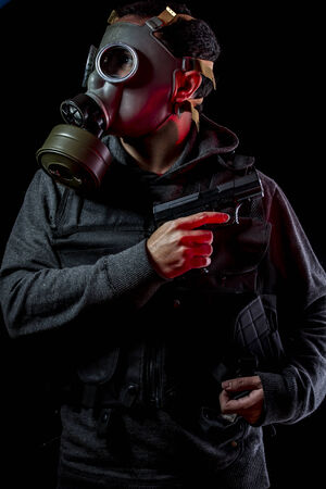 Private detective with bulletproof vest and gas mask, toxic photo