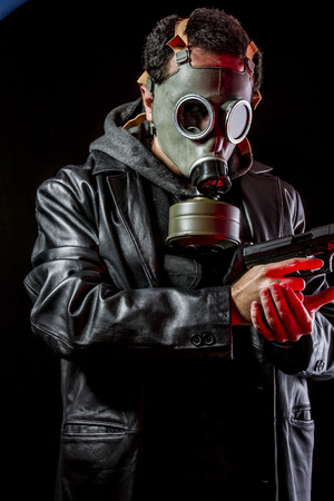 Special Private detective with bulletproof vest and gas mask photo