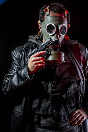 Private detective with bulletproof vest and gas mask, gear photo