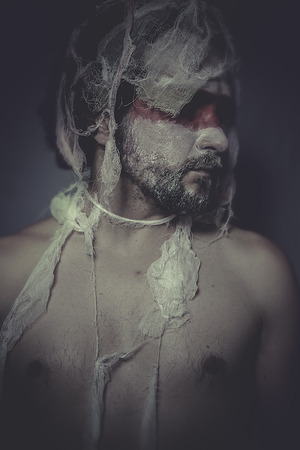 Problems, man with lace veil and bandages, wound concept, pain and suffering photo