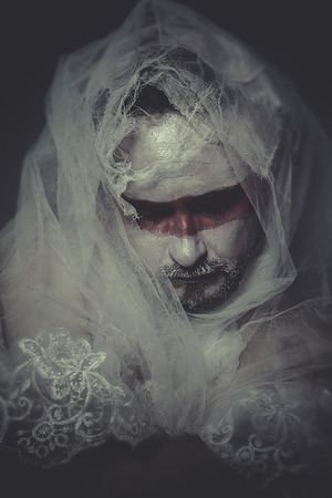 bandaged: man with lace veil and bandages, wound concept, pain and suffering