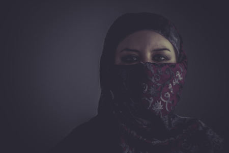 Arab mysterious woman with purple lace veil photo