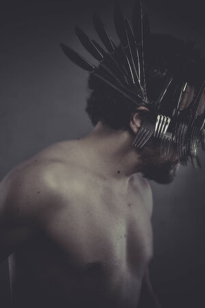 King, man with crown made of silver forks and knives photo