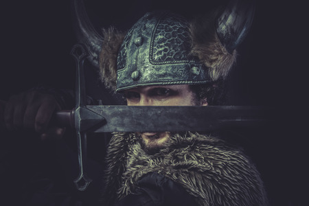Leadership, Viking warrior with a huge sword and helmet with horns photo