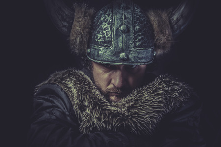 Costume, Viking warrior with a huge sword and helmet with horns photo
